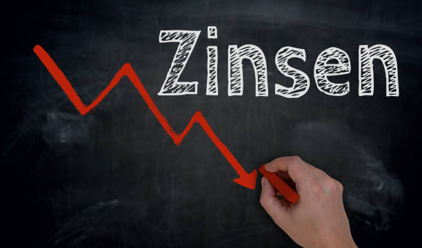 Zinsen (in german Interest) and graph is written by hand on blackboard Zinsen (in german Interest) and graph is written by hand on blackboard. minus sign stock pictures, royalty-free photos & images