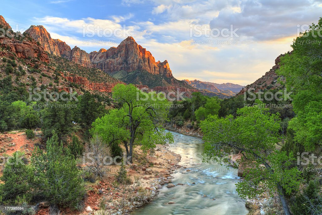 Zion Canyon Sunset HDR HDR image of the last rays of sun hitting The Watchman with the Virgin River in the foreground in Zion National Park, Utah. Canyon Stock Photo