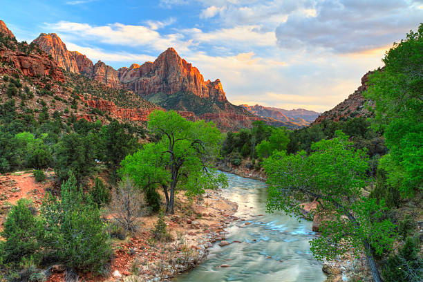 Zion Canyon Sunset HDR HDR image of the last rays of sun hitting The Watchman with the Virgin River in the foreground in Zion National Park, Utah. zion national park stock pictures, royalty-free photos & images