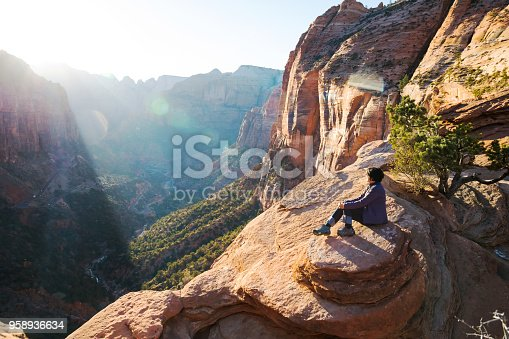 mature woman enjoying sunset at lookout point in Zion National Park