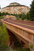 A road leads through the rugged and beautiful landscape of Zion National Park near Springdale, Utah.