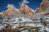 New snow on red rocks at Big Bend along the Virgin River in Zion National Park Utah
