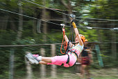 istock Zip lining in blurred motion! 1066494044