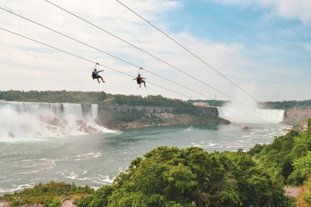 Zip Lining in Niagara Falls Canada side Niagara Falls offers some great entertainment all year around including Zip Lining. zip line stock pictures, royalty-free photos & images
