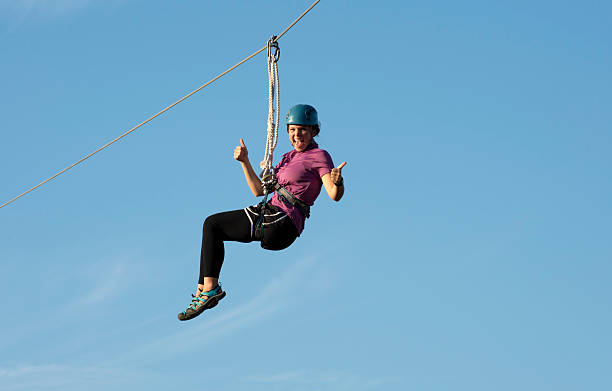 Ziping Girl on Canopy Tour  zip line stock pictures, royalty-free photos & images