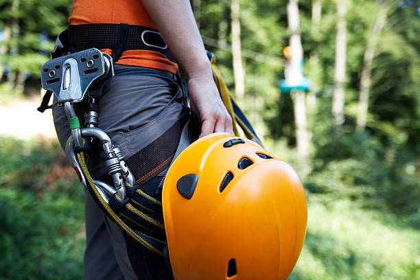 zip-line gear professional climbing gear with helmet pulley and carabiner zip line stock pictures, royalty-free photos & images