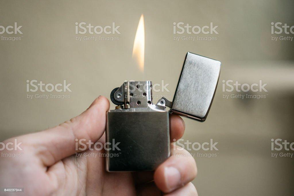zippo lightner with small fire stock photo