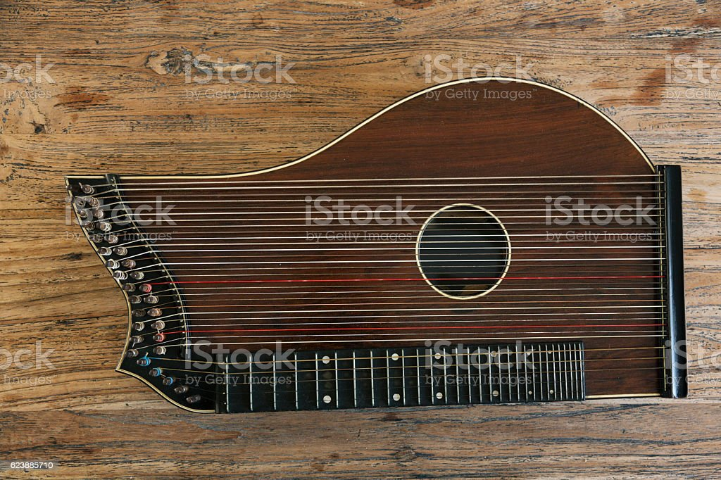 Zither-traditional musical instrument on wood from above stock photo