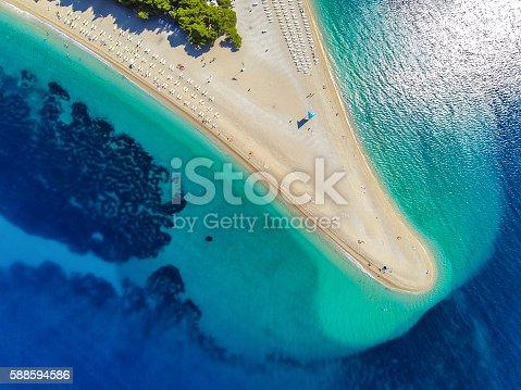 Famous beach Zlatni rat (Golden Horn or Golden Cape), Bol, Brac island, Dalmatia, Croatia, Europe. High angle view from quadcopter Phantom 2 with GoPro Hero 3 Black camera.