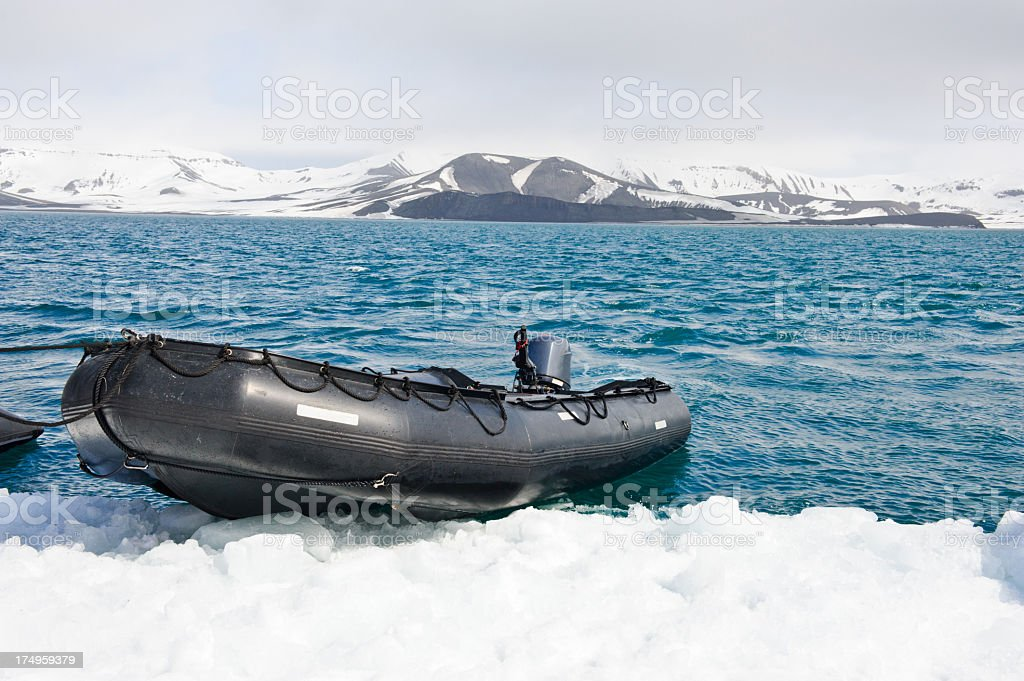 Zodiac parked on ice royalty-free stock photo