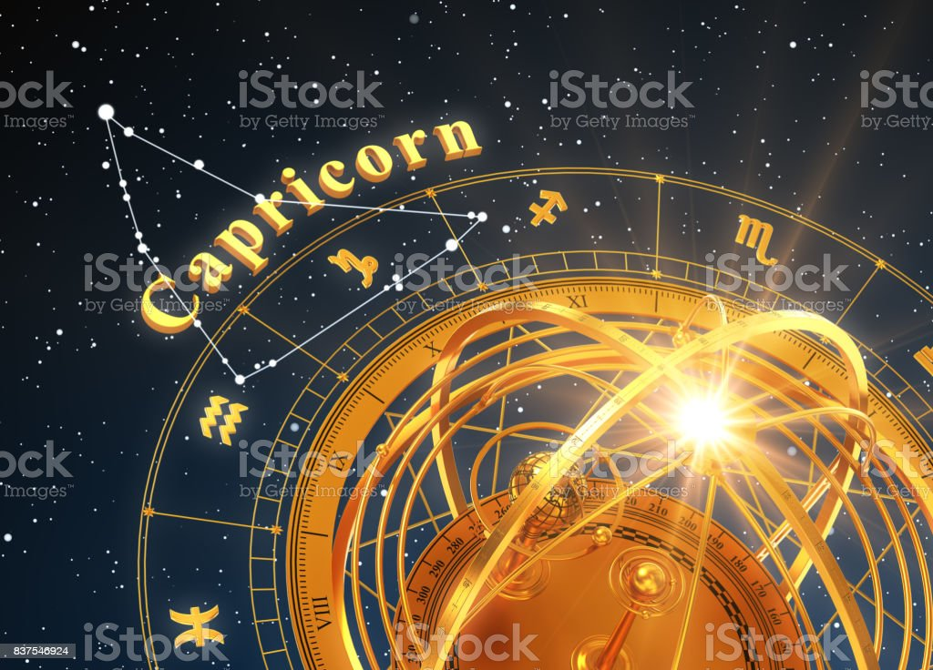 Zodiac Sign Capricorn And Armillary Sphere On Blue Background stock photo
