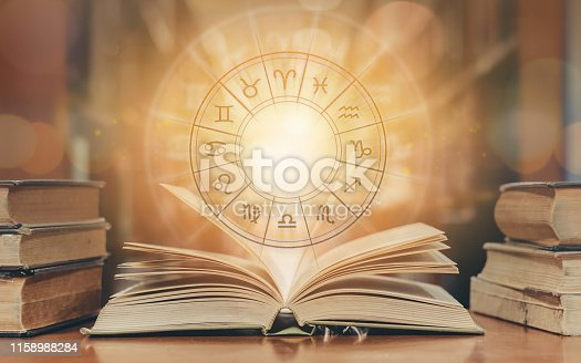 istock Zodiac sign horoscope astrology and constellation study for foretell and fortune telling education course concept with horoscopic wheel over old book in school library 1158988284