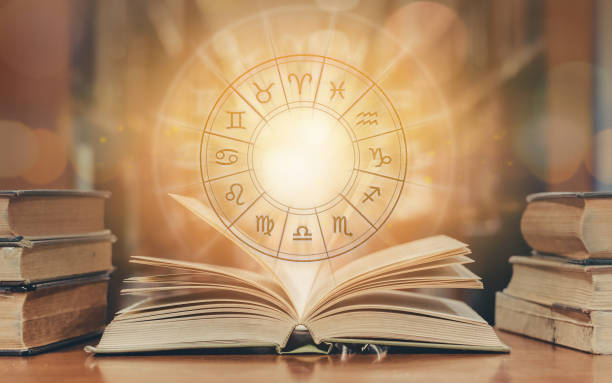 zodiac sign horoscope astrology and constellation study for foretell and fortune telling education course concept with horoscopic wheel over old book in school library - astrologia imagens e fotografias de stock