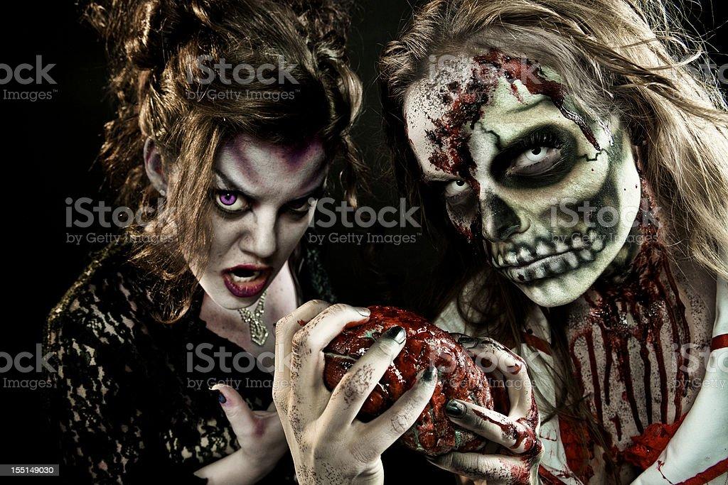 Zombie and Vampire Feeding royalty-free stock photo