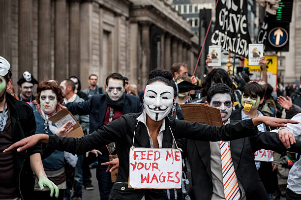 zombie bankers dance - guy fawkes mask stock photos and pictures