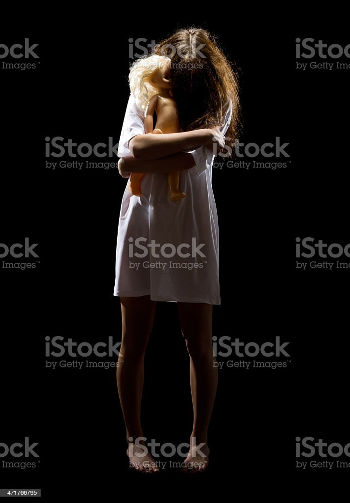 Zombie girl with plastic doll royalty-free stock photo