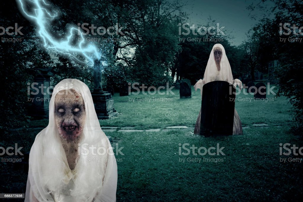 Zombie Graveyard Ghosts With Lightening stock photo
