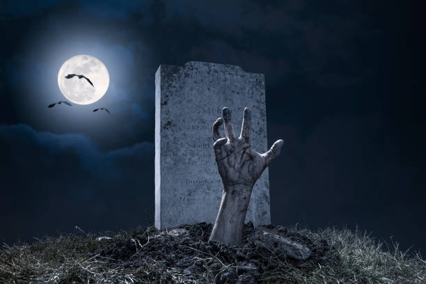 zombie hand halloween graveyard night monster scary - cemetery stock photos and pictures