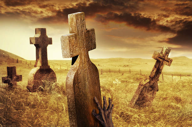 zombie hand on tombstone in creepy cemetery - demoniac stock pictures, royalty-free photos & images