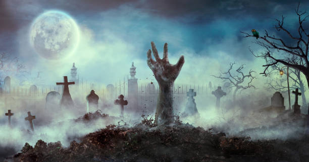 Zombie hand rise from the grave stock photo