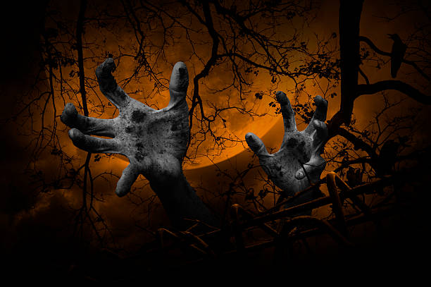 zombie hand rising out from old fence over dead tree - croak stock pictures, royalty-free photos & images