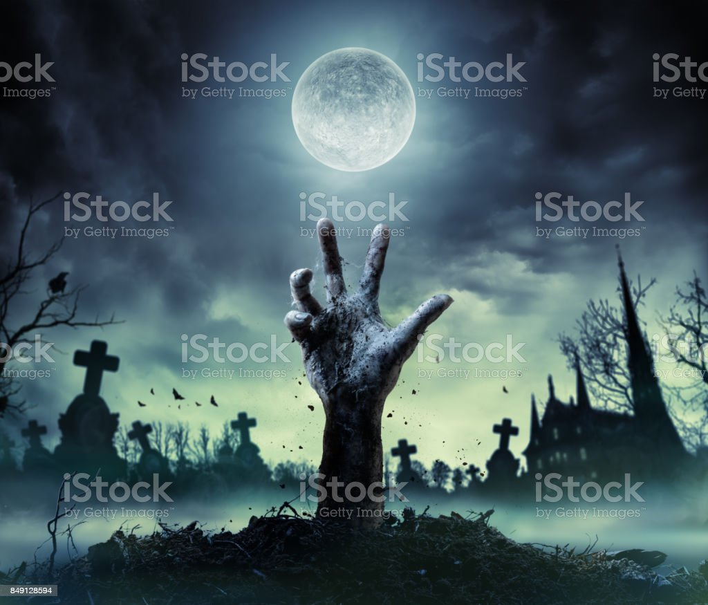 Zombie Hand Rising Out Of A Grave