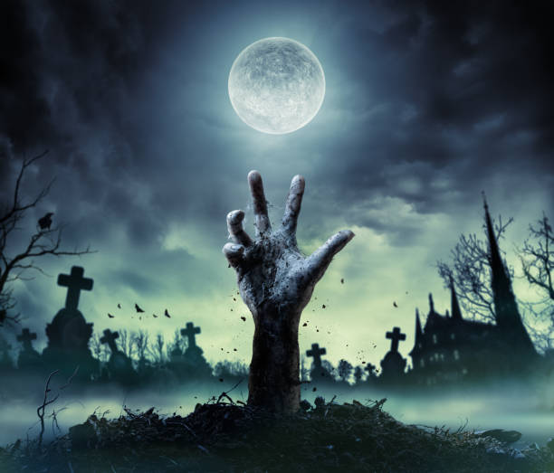 zombie hand rising out of a grave - horror stock pictures, royalty-free photos & images