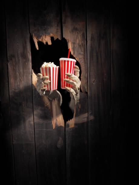 Zombie hand through hole cracked in rustic woodhalloween theme picture id1029892810?b=1&k=6&m=1029892810&s=612x612&w=0&h=mkshjrblsjmiwnpa7qvl1uteok3mqnklhtcvc05sgy4=