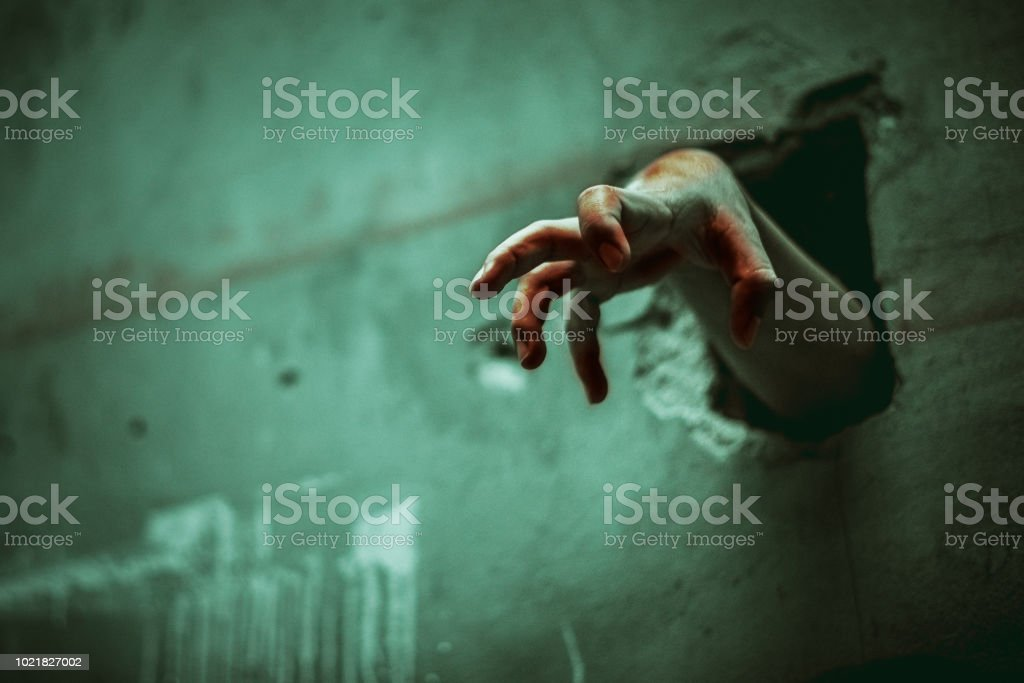 Zombie Hand Through The Cracked Wall Horror And Scary Film Concept