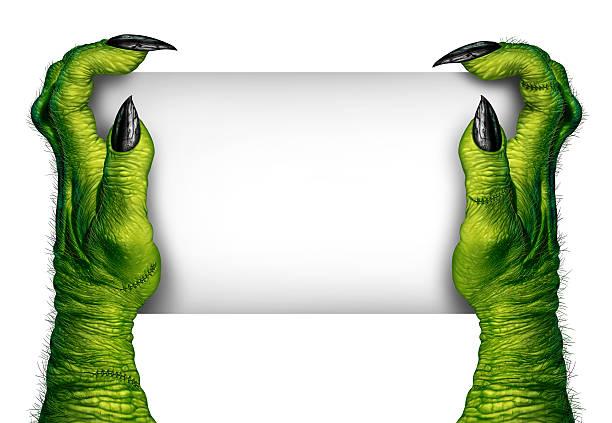 zombie manos sosteniendo señal - monstruo fotografías e imágenes de stock