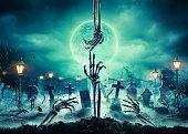 Bones Zombie Hands Rising In In Dark Halloween Night - Cemetery With Full Moon