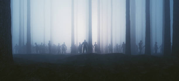 zombie hordes in the forest at night - zombie apocalypse stock photos and pictures