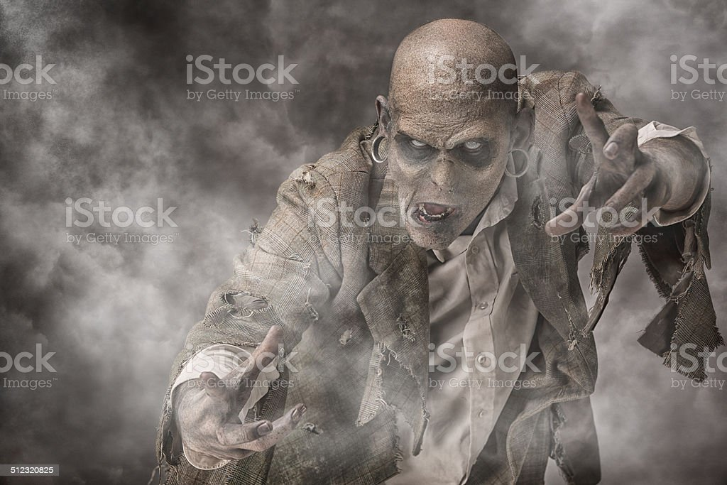 Zombie in the fog stock photo