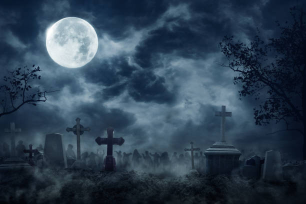 zombie rising out of a graveyard cemetery in spooky dark night - cimitero foto e immagini stock