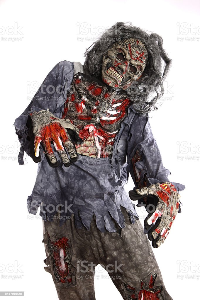 A zombie with tattered clothes on a white background royalty-free stock photo