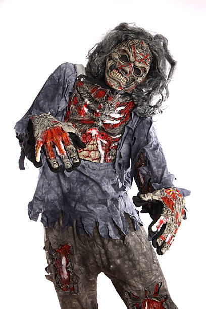 A zombie with tattered clothes on a white background stock photo