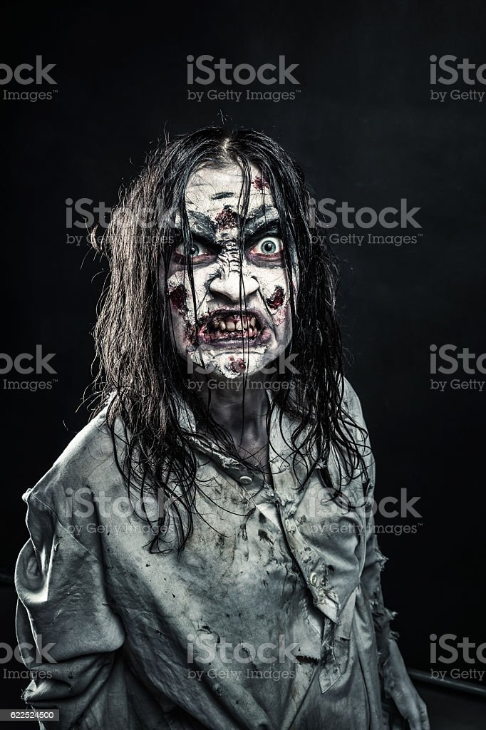 Zombie woman with bloody face stock photo