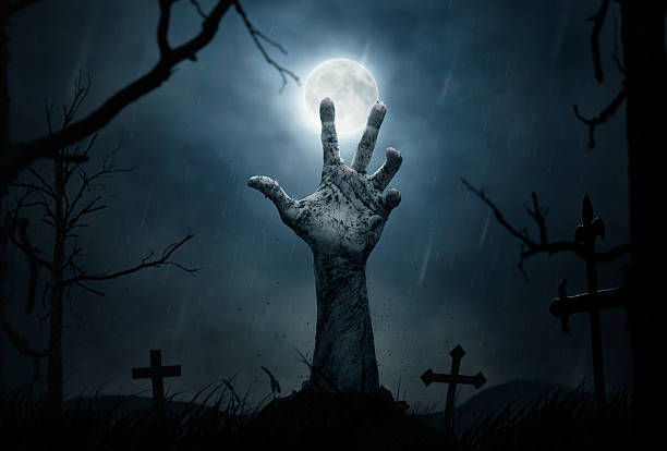 zombie's hand - cemetery stock photos and pictures