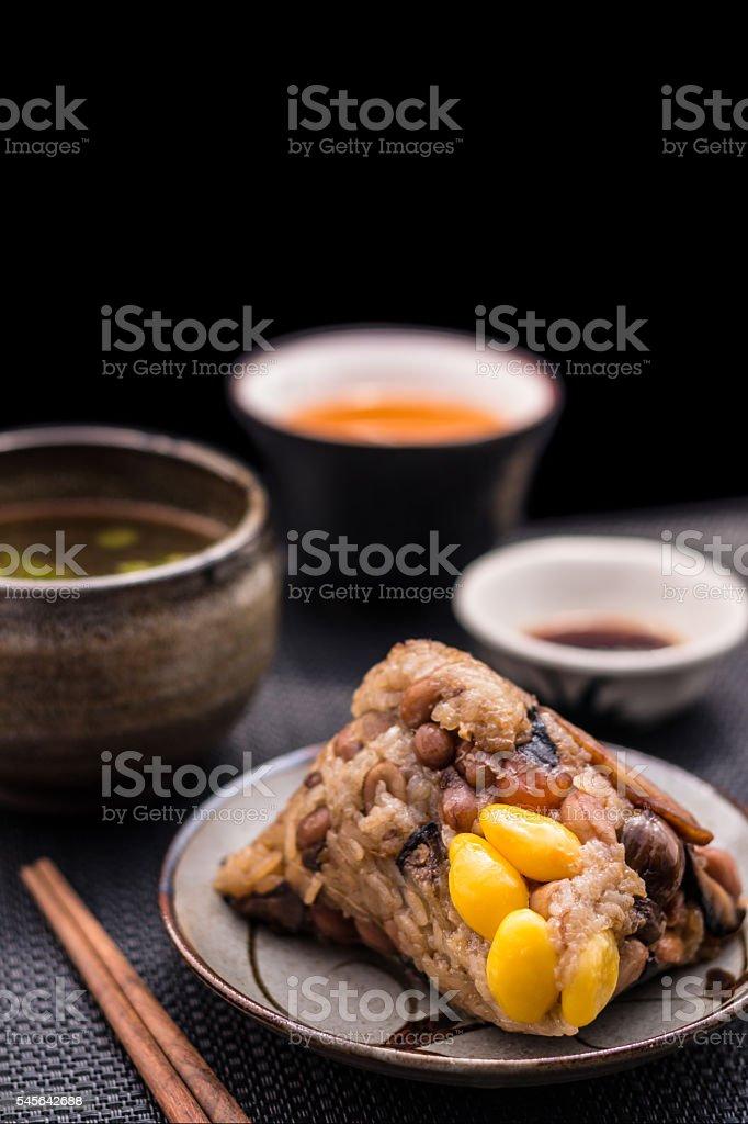 Zongzi or Asian Chinese sticky rice dumplings stock photo