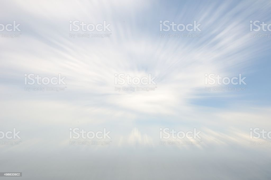 Zoom Burst Blue Sky with Clouds stock photo