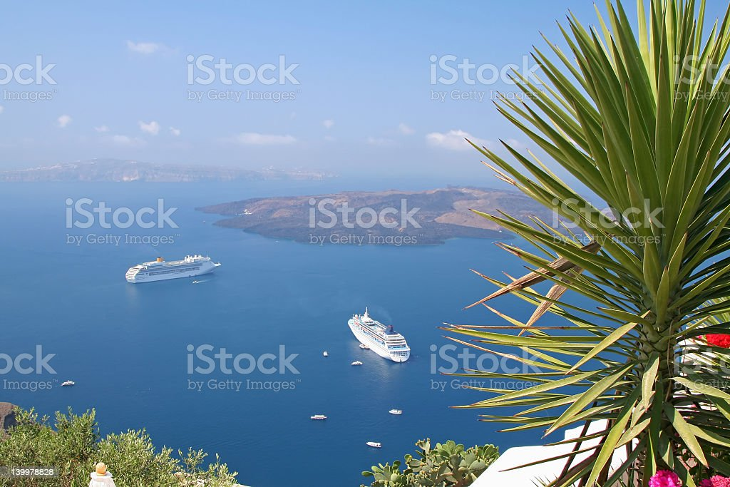 Zoomed out view of cruise ships in Santorini royalty-free stock photo