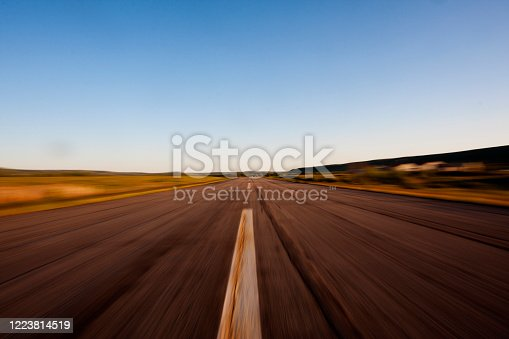 A motion-sickness-inducing shot of a small, rural airport runway with a zooming effect that gives the viewer the illusion that they are zooming down the runway on takeoff or landing.  Shot at the small rural airport in the mountain town of Council, Idaho, USA