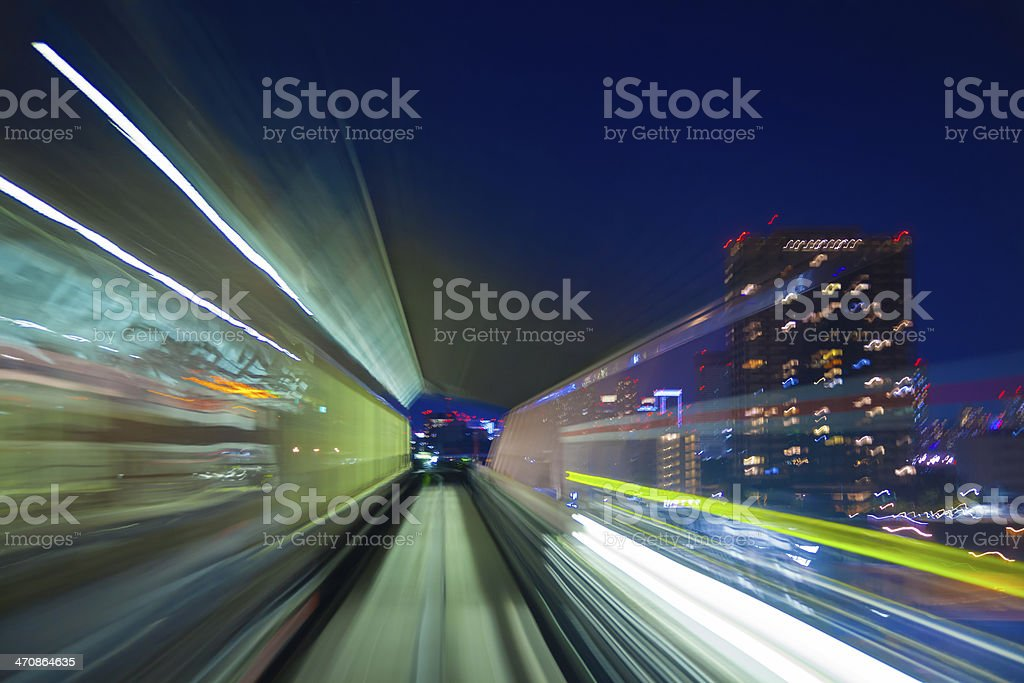 Zooming light trails from a speeding train stock photo