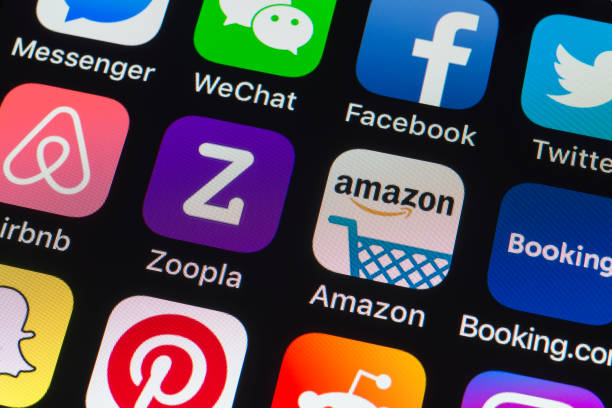 Zoopla, Amazon, Booking.com and other phone Apps on iPhone screen stock photo