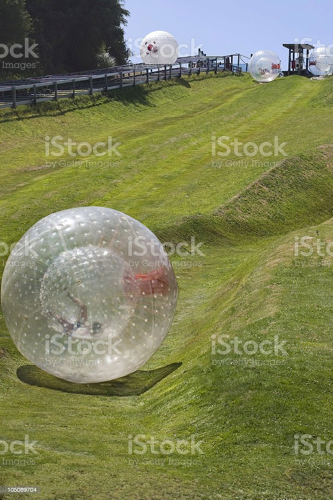 Zorbing down a hill stock photo