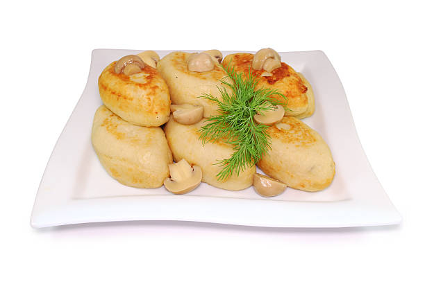 zrazy with mushrooms isolated against white background. national ukrainian, lithuanian - kartoffelroulade stock-fotos und bilder