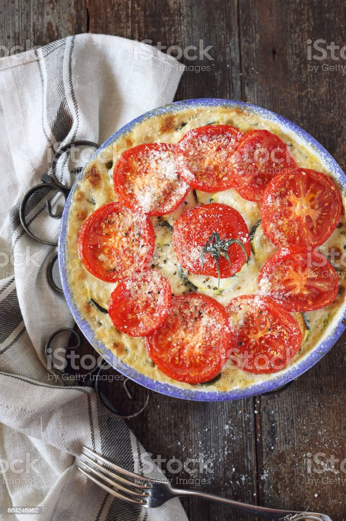 Zucchini and tomatoes gratin with cheese royalty-free stock photo