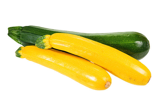 zucchini and yellow squash isolated - courgette stockfoto's en -beelden
