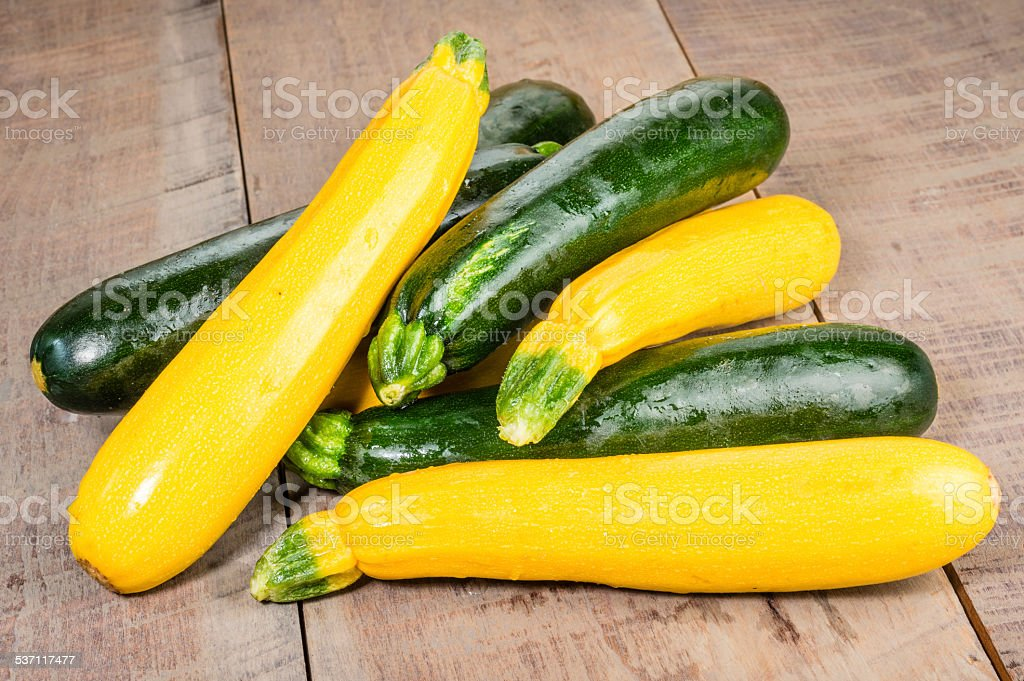 Zucchini and yellow squash on table stock photo