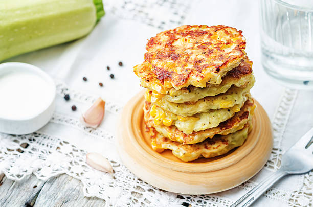 zucchini corn fritters zucchini corn fritters on a white background. the toning. selective focus fritter stock pictures, royalty-free photos & images